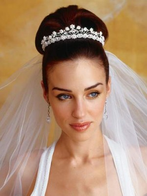 bun hairstyle with tiara for wedding