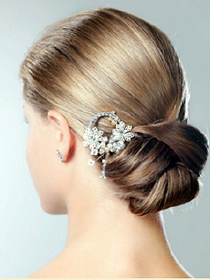 chic low bun with hair clip