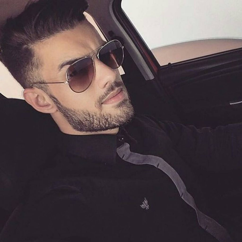 mens modern hairstyle with stubble beard