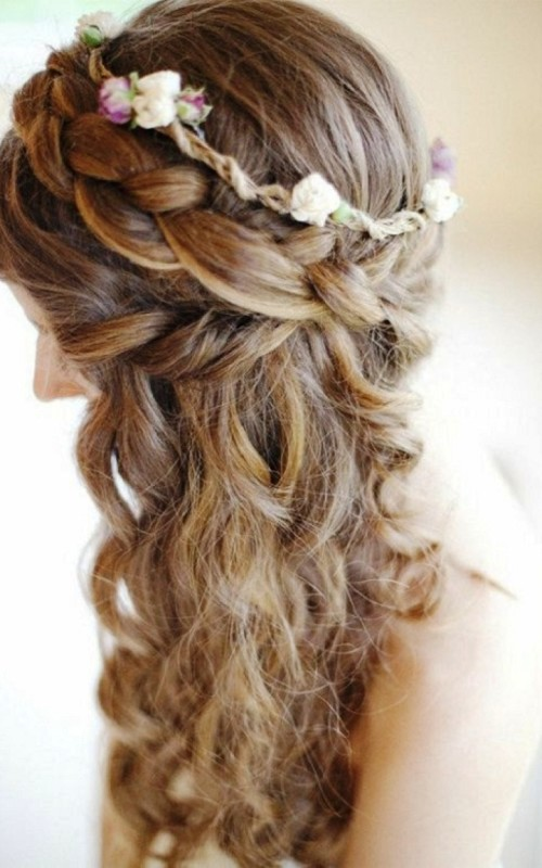 braided curly half updo hairstyle 2022