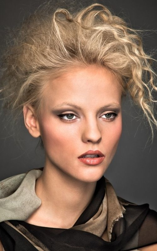 messy crimped updo hairstyle 2022